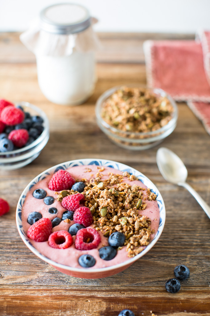 My grain-free granola is the perfect topping for this coconut yogurt smoothie bowl with fresh berries.