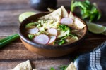 Garnishes are essential to Chicken Tortilla Soup - think cilantro, avocados, cheese, scallions, sliced radishes, and of course, corn tortilla chips!