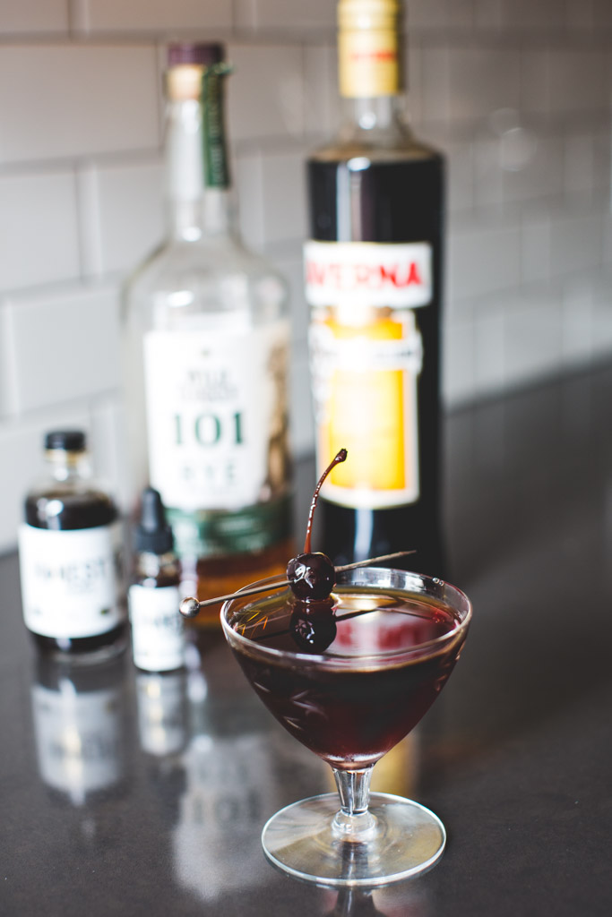 Black Manhattan with Averna Amaro, Wild Turkey 101 whiskey and Honest John's Black Walnut Bitters.