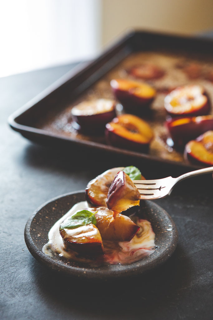 Enjoy each bite of roasted plums with a bit of fresh basil.