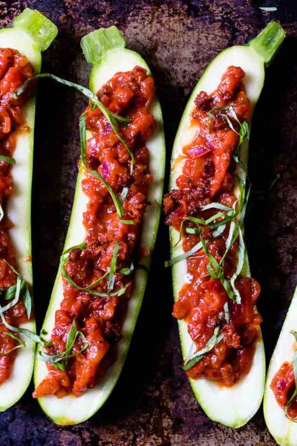 These Weight Watchers friendly super easy zucchini pizza boats are the perfect weeknight dinner. Rich tomato sauce, topped with cheese and chorizo. 30 min. www.saltedmint.com