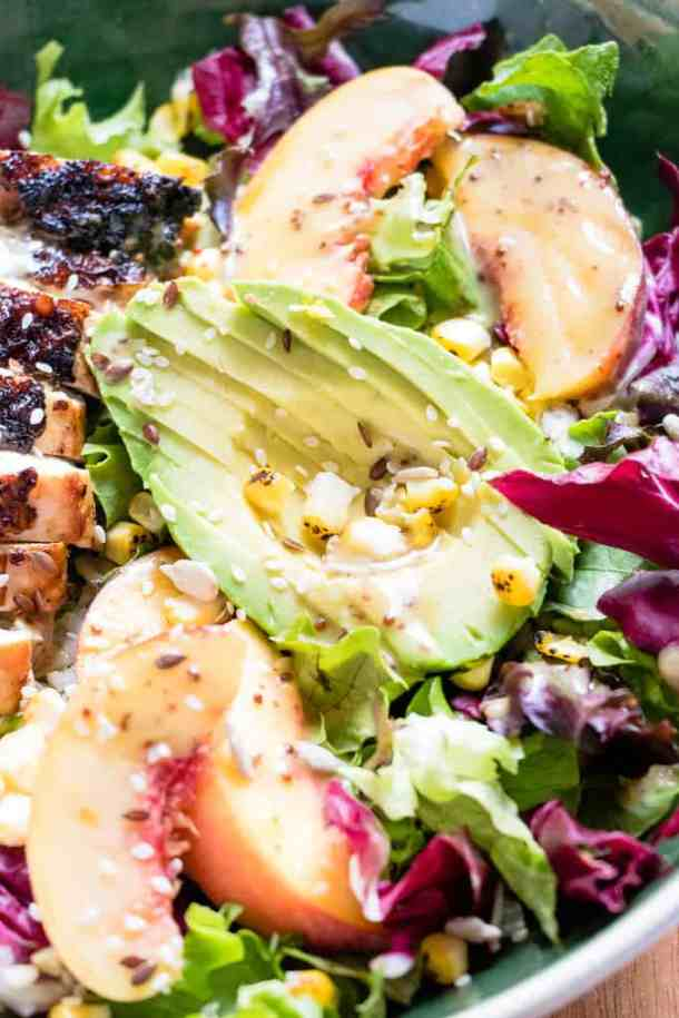 Peachy Maple Chicken And Roasted Corn Rice Salad. | This grilled maple mustard chicken is paired with fresh peaches and wild rice. A perfect salad meal.