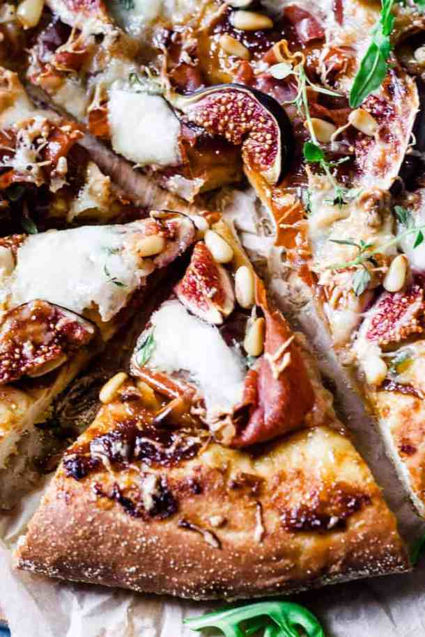 This fig and prosciutto pizza is the perfect dinner lifesaver. Ditch the pepperoni and jazz up pizza night with onion marmalade, juicy ripe figs and creamy salty prosciutto.
