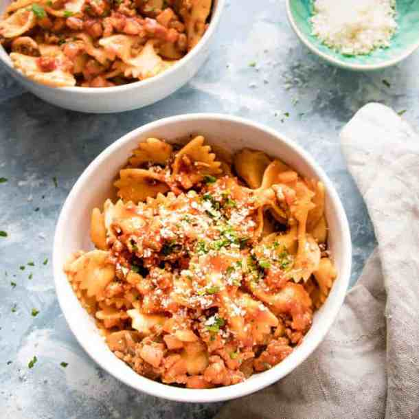 This simple bolognese sauce is a modern take on the cosy comfort classic. Rich meaty sauce loaded with herbs and spices and Vegetables. It skips the long simmer and comes together in under an hour.