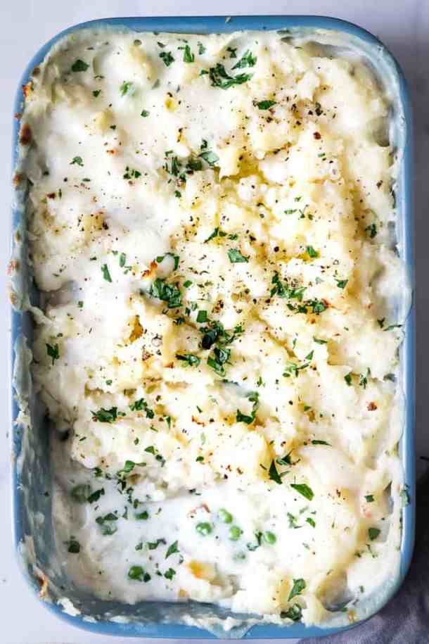 A simple celeriac topped fish pie recipe that's super cozy and quick and easy to prepare. It's perfect to be portioned into ramekins and frozen for quick toddler meals or cook in a big dish for the perfect family supper.
