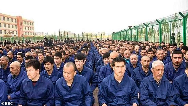 Detainees listening to speeches in a camp in Lop County, Xinjiang, China