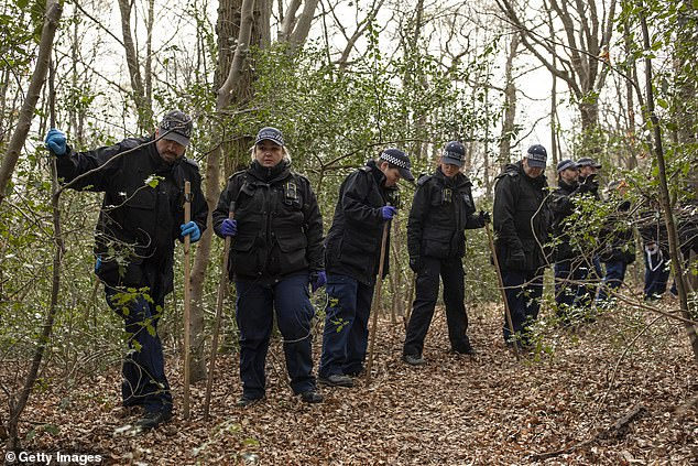 Essex Police search team pictured in Epping Forest, north-east London. April 1