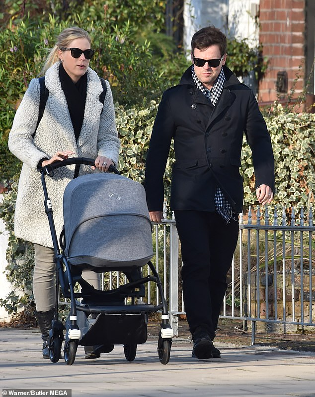 Dec Donnelly's £5million home was targeted by a 'professional' burglary gang while the TV star was asleep upstairs with his wife and young daughter (pictured together)