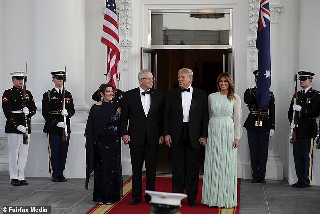 US President Donald Trump (second right) and First Lady Melania Trump (right) greet Australian Prime Minister Scott Morrison (second left) and his wife, Jenny Morrison (left), ahead of a state dinner at the White House, September 20, 2019
