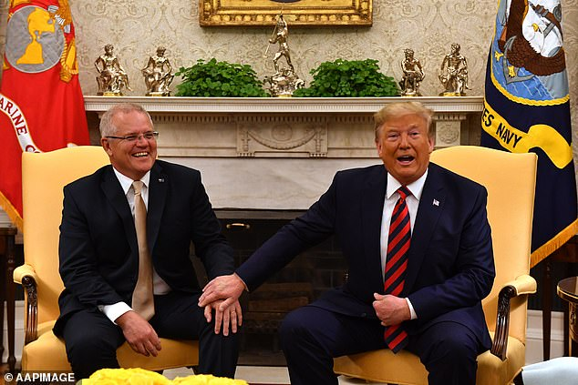 Donald Trump showered Scott Morrison with more than $10,000 worth of gifts during his time in office (pictured together during a meeting in September 2019 at the White House)