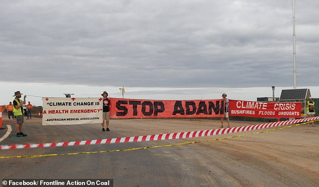 Protesters have tried to blockade a rail construction site at the controversial Carmichael coal mine project in central Queensland