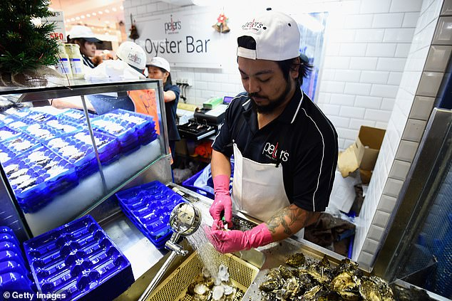 Workers at the Sydney Fish Market can also expect to see less oysters over the next few months - or even years (stock image)