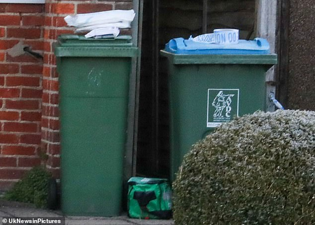 Detective Superintendent Kevin Brown of the Major Crime Team said: 'We are currently in the very early stages of this investigation.' Pictured are packages outside the house