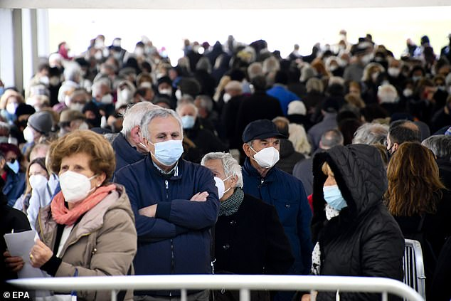 The data is calculated based on the number of deaths at a specific age in a period of time. The pandemic has led to thousands of deaths, many of the premature, in a short period of time, forcing life expectancy down (pictured, Italians wait to get vaccinated)