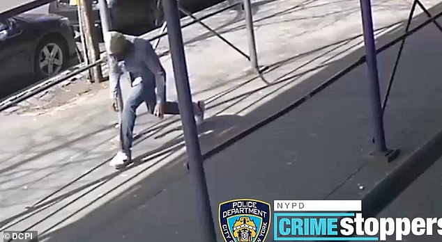 SUSPECT: Surveillance video shows unidentified male ducking under a rail prior to the attack