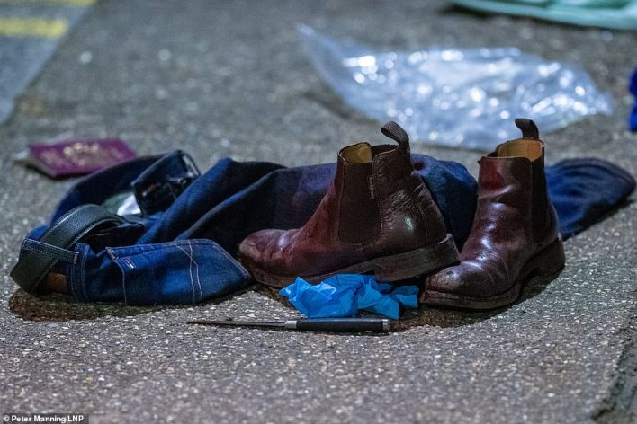 Found: Knife, shoes, jeans and a passport on the ground at the scene of the crash