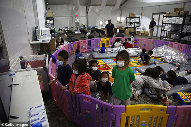 Some of the youngest unaccompanied migrants, as young as three, sleep, eat and play in separate rooms, corralled by a plastic baby gate. Human rights groups have criticised the decision to hold children in such unsuitable accommodation