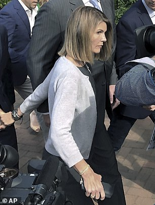 In 2019, Wilson was charged alongside other wealthy parents including Lori Loughlin and Felicity Huffman, both of whom have already served jail time. Loughlin is pictured