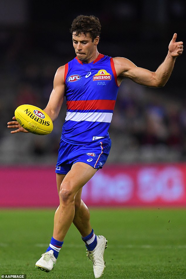The 24-year-old said his Instagram direct messages were flooded with abuse after he missed an easy goal in a clash against Sydney Swans in 2018. Dunkley is seen in action during a pre-season match on March 8 this year