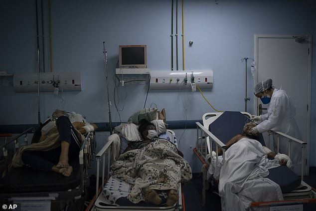 Patients are treated on a Covid ward at a hospital inRio de Janeiro state, Brazil, as they wait to be tested for the virus