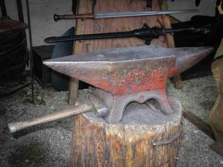 A tree stump anvil stand