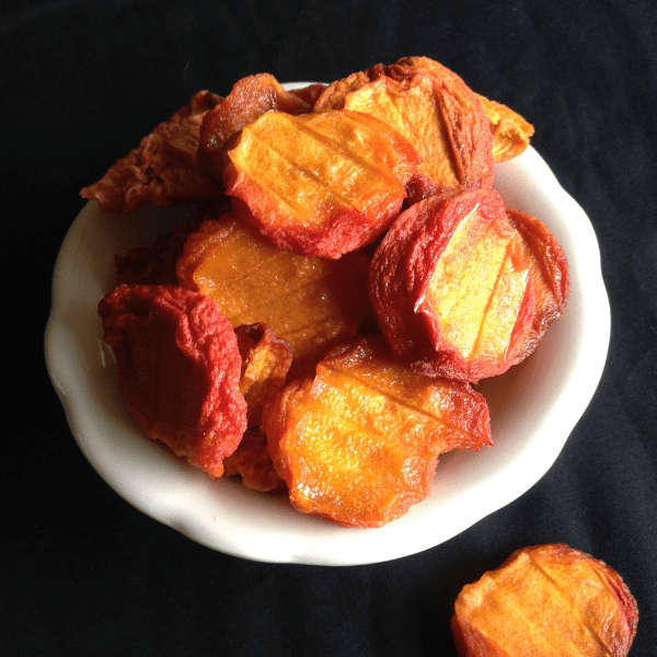 perfectly dried peaches in a dehydrator