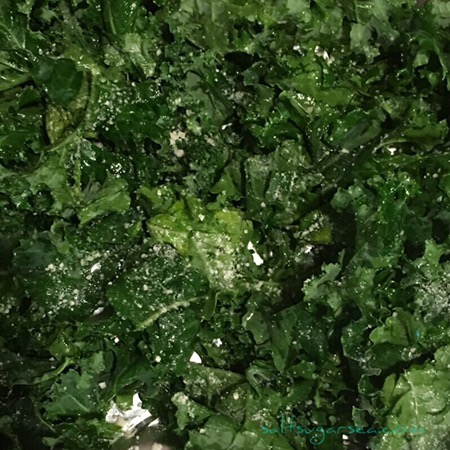 Raw kale tossed with olive oil to roast for citrus roasted kale recipe