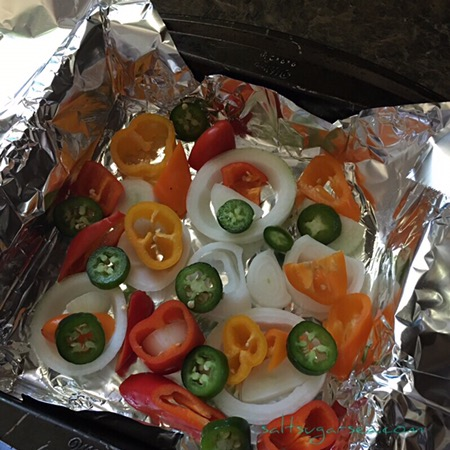 Onions and peppers getting ready to be roasted with a bison brisket