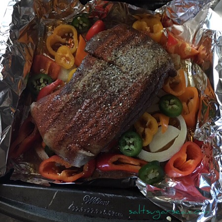 Cumin and chile pepper seasoned Bison Brisket over peppers and onions