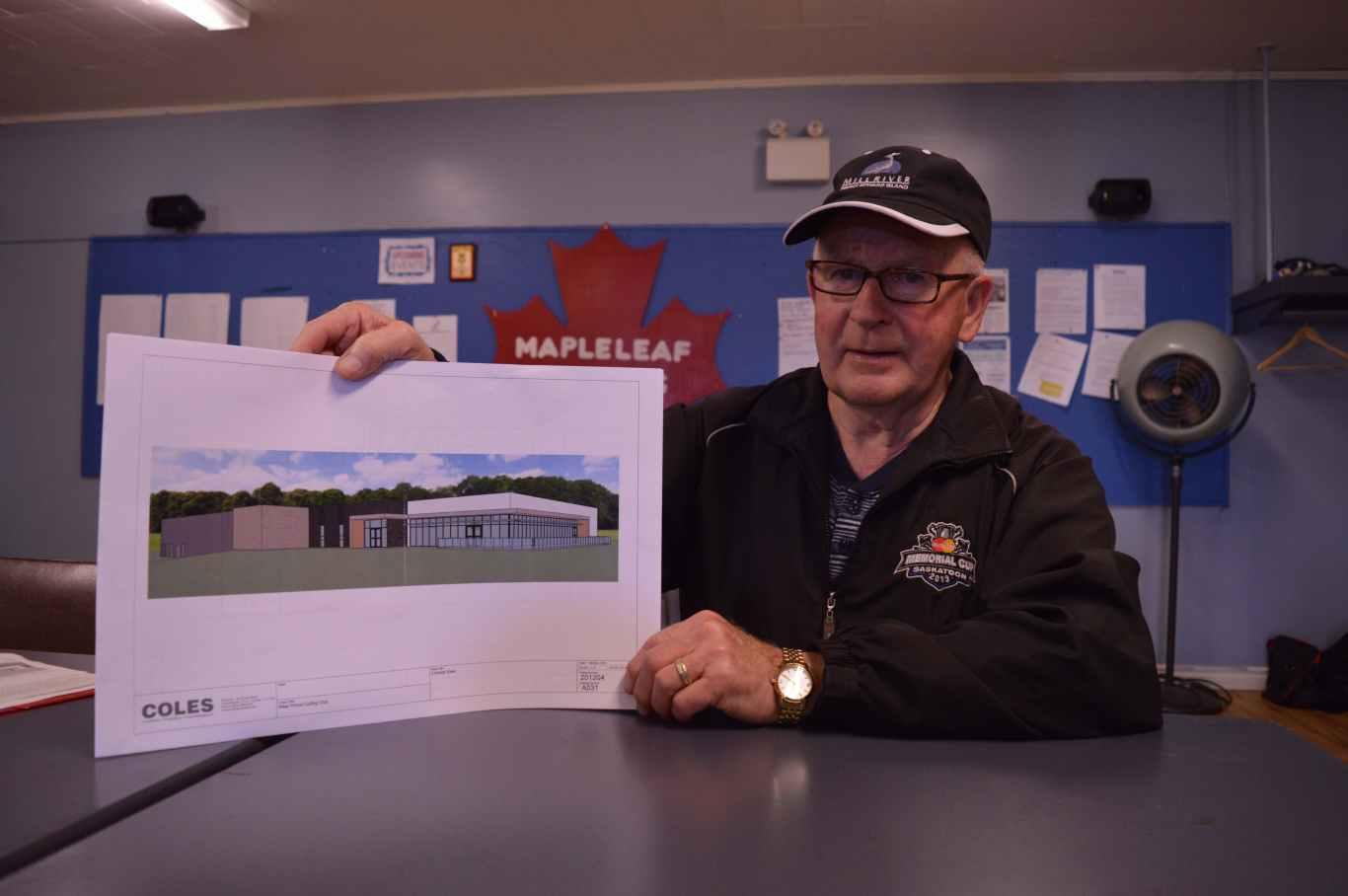 Clair Sweet, president of the interim Western Curling Club board, shows an architect's image of the new club planned for Mill River Resort.