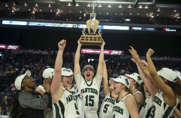 Prince Edward Island Panthers centre Carolina Del Santo hoists the AUS women's basketball championship  trophy after the Panthers beat Acadia 78-59 in Sunday's  final. Ryan Taplin - The Chronicle Herald