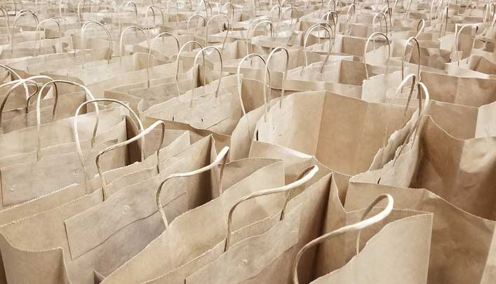 Grocery Store Bagger Forced to Pay Retroactive Bag Fees, But Why?
