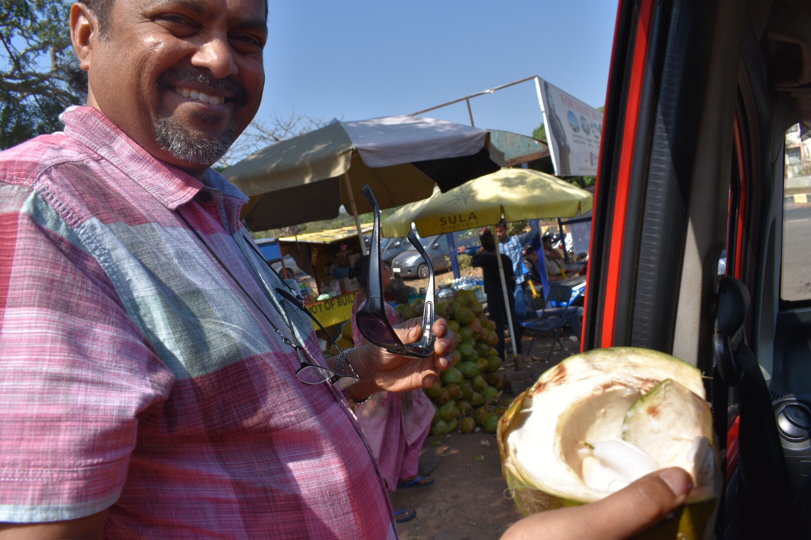 Father with a tender coconut