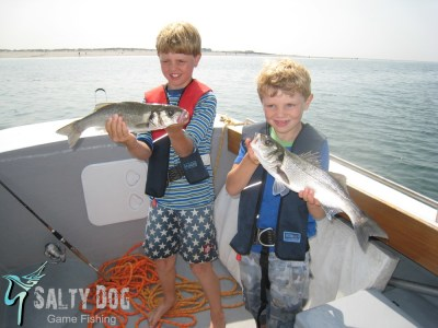 salty dog fishing - children holding bass they caught