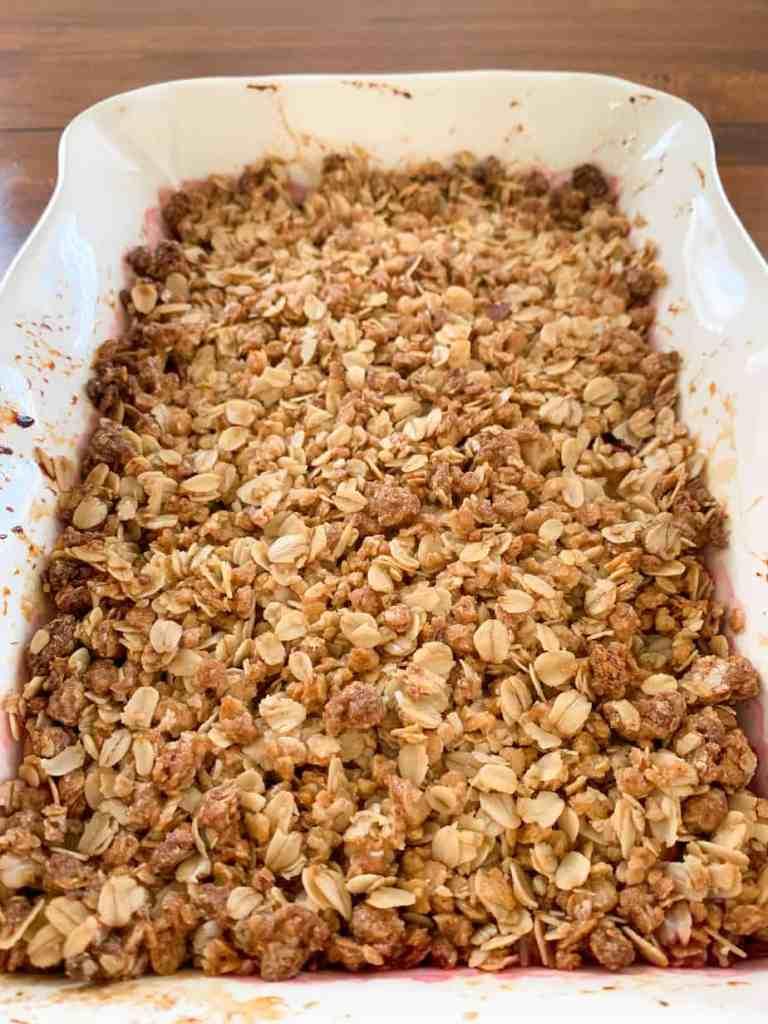 fruit crisp in a white baking dish