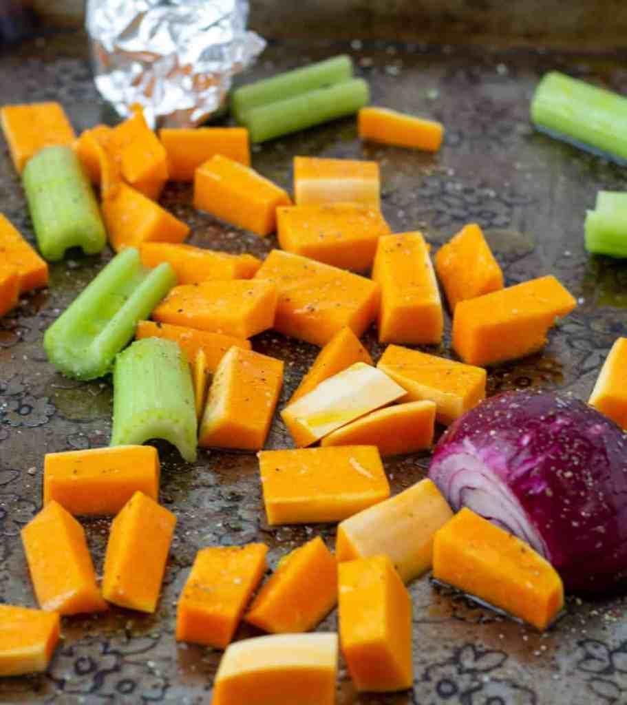 raw veggies on a sheet pan