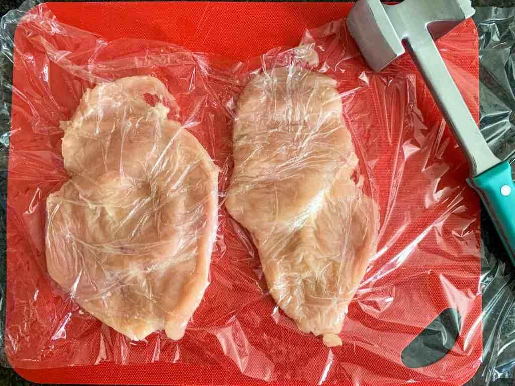 raw chicken on a cutting board