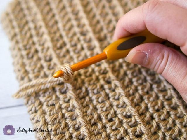 Pull the tails through with your crochet hook.