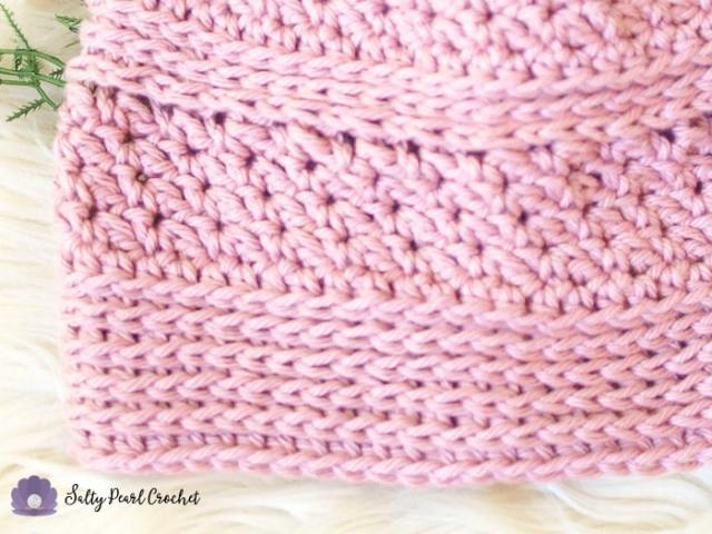Closeup of a pink hat made from Linda's Easy Crochet Chemo Cap Pattern to show the texture of the cotton yarn.