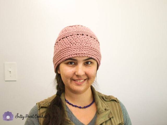 d2e5e907a14 Woman smiling wearing a pink hat made from Linda s Easy Crochet Chemo Cap  Pattern