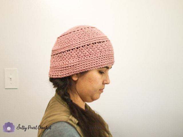 Woman wearing a pink crochet chemo cap for summer made of cotton yarn