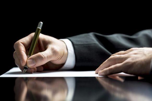 Executive man writing