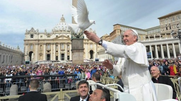 Pope Francis with a dove