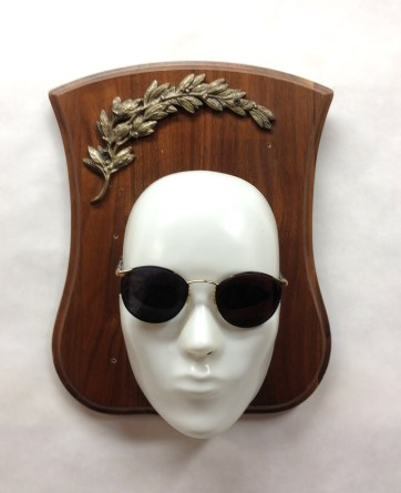 Mounted Face~Found Objects~10X3X12