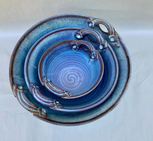 Handmade nested pottery bowl blue