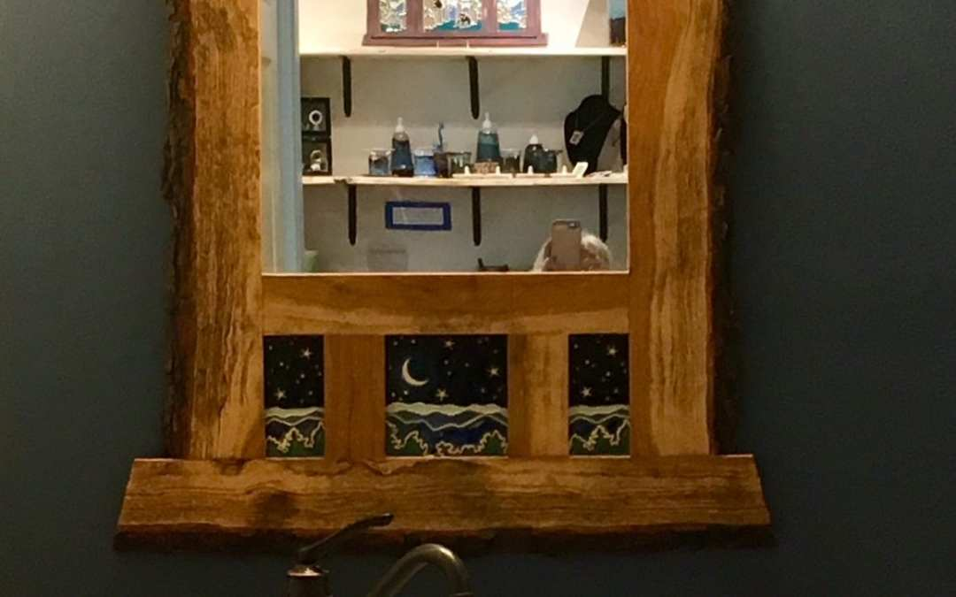Vessel sink and handmade mirror