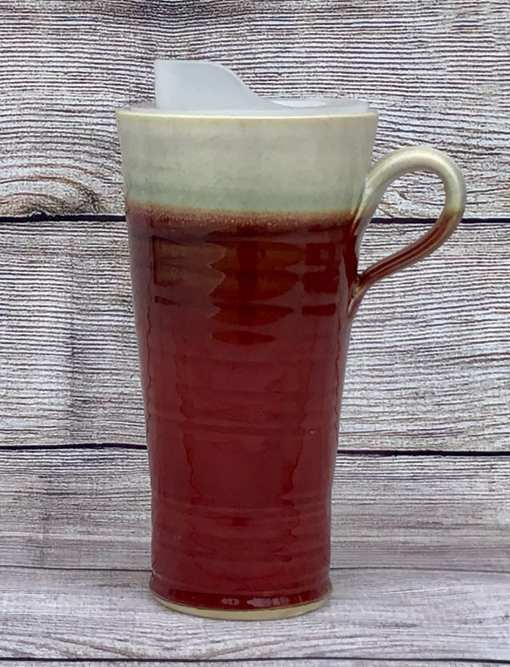 Red travel mug by salvaterra pottery