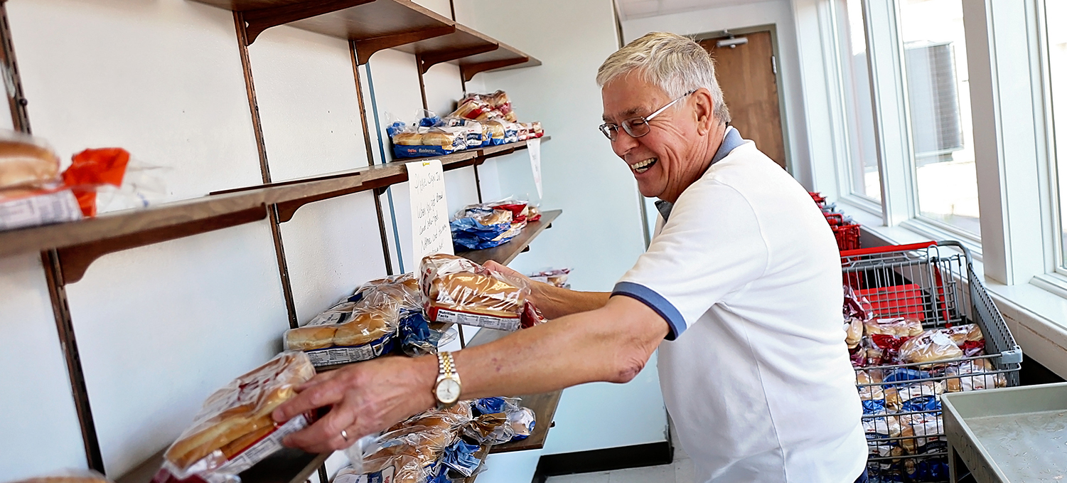 volunteer stocking shelves at TSA food pantry