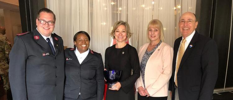 """Broker/Owner, Al Abbitt, and Director of Operations, Brooke Scutt, were presented the award for """"2017 Donor of the Year"""" by The Salvation Army"""