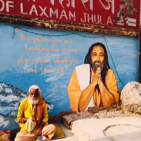 local yogi being blessed by mooji mural in rishikesh